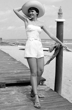 A white strapless playsuit, particularly one with a tailored shape and belted waist, was perfect for the beach back in 1950 – and is still perfect now.