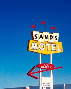 A fine art photo of the Sands Motel neon sign, located in Grants, New Mexico. Photograph by Martin Garfinkel.
