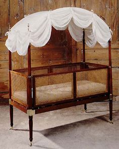 """Rare George III brass bound mahogany and caned child's campaign bed, labeled, """"Morgan and Sanders, 16 and 17 Catherine Street, London."""" Completely collapsible. English, c. 1805"""