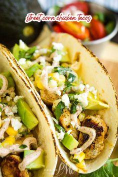 Street Corn Chicken Taco Recipe are loaded with marinated chicken, street corn then topped with avocado, cheese, & sauce! #recipe #TexMex #taco #softtacos #chickentacos #chicken #grilledchicken #corn #streetcorn #avocado #crema