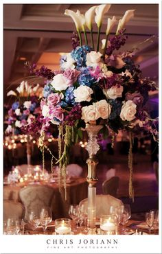 Larger-than-life floral arrangements of purple, white and blue blooms featured roses and calla lilies at a @Four Seasons Resort Palm Beach wedding.