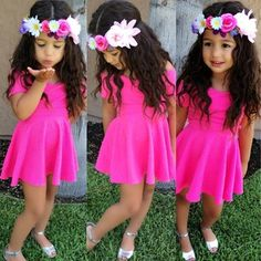 Putting a flower headband on a little girl. Too cute