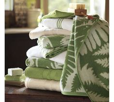 Variety of green and white bath towels