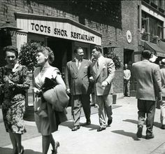 "The famous Toots Shor...""Where the elite meet to eat.""  This shot shows Joe Dimaggio & Jackie Gleason in front of the restaurant."