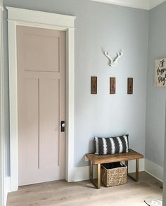 Door paint color: White Truffle by Sherwin-Williams Wall paint color: Northstar by Sherwin-Williams Trim paint color: Extra White by Sherwin-Williams