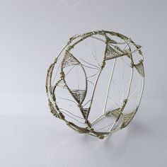 "Lena Franolic, ""a web of triangles"" bracelet.  oxidized and non-oxidized silver wire.  2010."