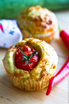 Muffins with zucchini and cheese with cherry tomatoes inserted - aren't they beautiful?