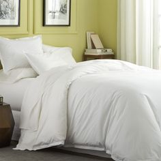 "Beautiful double flanges frames duvet's every side, accented with subtle serged stitching for a clean and casual look.  Duvet has bottom button closure.  100% cotton percale. 200-thread-count. Machine wash cold; tumble dry low; warm iron as needed. Button closure; $150; 106""x96"""