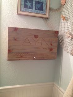 Bathroom cabinet made from wine crate... stained with aged oak stain that gives it the gray  beach wood look.