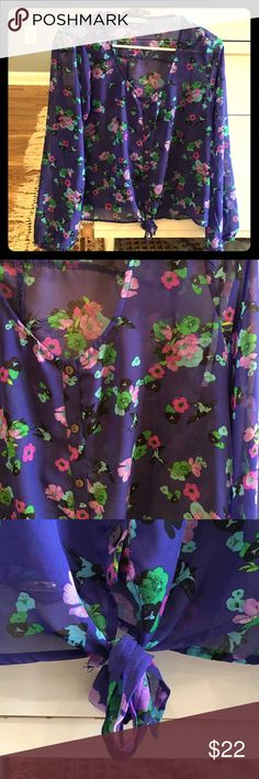 Floral crop top Love this shirt. So sad it doesn't fit anymore! Adorable floral patten. Can be worn as a crop top or a regular on shorter people. Has the tie bottom to help anchor it shorter or longer. It's a blue ish purple. freebird Tops Blouses