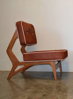Anonymous; Wood and Cowhide Lounge Chair, 1960s.