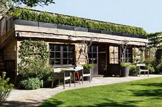 Garden Shed Studio in Garden Room Design Ideas. This garden cabin with green roof functions as an entertaining space and cinema room.
