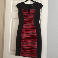 Cute black and red dress Black dress with red accents in front. Zips up back and has cap sleeves. Very comfy. Worn once. Perfect condition. Dress Barn Dresses Midi