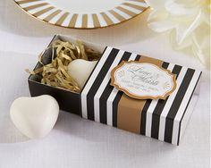"For a one-of-a-kind ""classic"" wedding favor, give guests something they're sure to use- like heart-shaped soap an elegantly designed black and white box!"