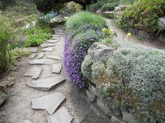 Rock Garden ideas - rock wall & plants next to path
