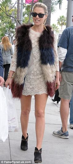 Ali Larter added a pop of colour with her blue, brown, cream and white fur gilet