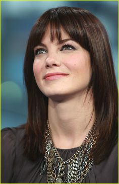 Michelle Monaghan. Long bob with bangs.