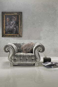 Striking in any setting, the Italian Designer Button Upholstered Armchair at Juliettes Interiors. In an ash grey finish with hand painted silver details. Also available in a 2 and 3 seater sofa, creating a fabulous collection!