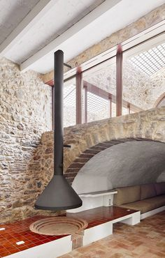 Spanish studio Arquitectura-G exposed the original brick walls of this farmhouse, composed of decades-worth of adaptations and extensions spread over three different levels, in order to make it feel like one cohesive whole. Farmhouse Renovation, Farmhouse Design, Terracotta Floor, Journal Du Design, Concrete Steps, Glazed Tiles, Built In Furniture, Stone Houses, Fireplace Design