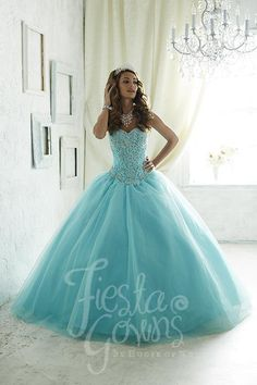 Sparkling tulle makes this ball gown pop, along with the bodice splashed with colored replica pearls and shining stones upon jaw-dropping embroidery. Download the Fiesta Gowns by House of Wu sizing ch