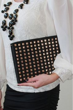 Black and gold studded clutch $39 keeps you looking fashionably chic! www.herringstonesboutique.com