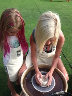 Tori working on her pottery project as Stella watches