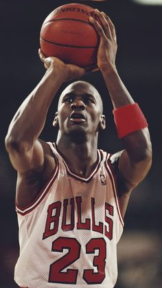 Michael Johnson shooting guard for the Chicago Bulls prepares to make a shot during a Central Division game in the Eastern Conference of the National Basketball Association (NBA) 1988 - 1989 season at Chicago Stadium, Chicago, United States. Chicago Bulls Tattoo, Chicago Bulls Team, Nba Bulls, Michael Jordan Pictures, Michael Jordan Photos, Michael Jordan Tattoo, Nba Players, Basketball Players, Basketball Tattoos