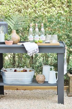 Elevate backyard entertaining with this DIY outdoor beverage station. Guests will never know it's a modified potting bench!