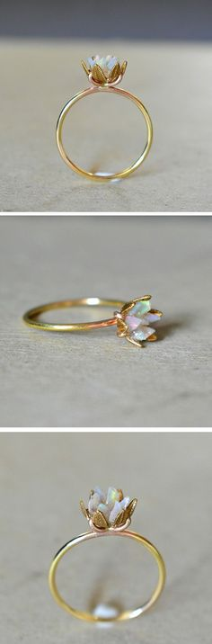 Pieces of raw opal complement each other to this beautiful lotus ring Pieces of raw opal complement each other . - Pieces of raw opal complement each other to form this beautiful lotus ring Pieces of raw opal compl - Lotus Ring, Opal Jewelry, Jewelry Rings, Jewelry Accessories, Gold Jewelry, Birthstone Jewelry, Jewellery Box, Jewlery, Jewellery Shops