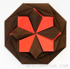 Origami Tato ... traditional folded purse for flat items ... could hold letters or invitations ... luv the geometric shapes created with two papers ...  red and black ...  wonderful modern look ...