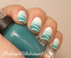blue to white gradient nails with diagonal lines
