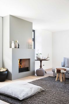 Fantastic living room with fireplace and large carpet. Very cozy interior . Fantastic living room with fireplace and large carpet. Scandinavian Fireplace, Home Living Room, Home, Home Fireplace, Fireplace Design, Minimalist Fireplace, House Interior, Interior Design, Home And Living