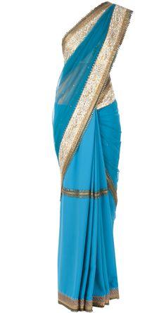 Blue sari with embellished net palla by J J VALAYA. http://www.perniaspopupshop.com/whats-new/j-j-valaya-blue-sari-with-embellished-net-palla-jjvc1013a2817.html
