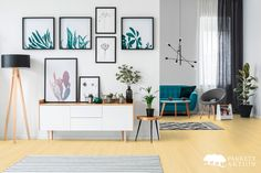 White living room interior with botanical posters on the wall and sofa in the background living room interior royalty free stock images stock photo Self Adhesive Wallpaper, Peel And Stick Wallpaper, Of Wallpaper, Blue Moroccan Tile, Moroccan Style, Vintage Interior Design, Living Room Interior, Living Rooms, Framed Art Prints