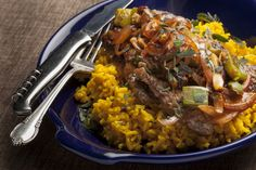 Minute Steaks with Picadillo-Style Sauce & Yellow Rice. Visit http://www.blueapron.com/ to receive the ingredients.