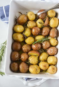 These rosemary roasted potatoes are mind -blowing on your taste buds! Plump baby potatoes roasted with aromatic rosemary and garlic taste amazing!