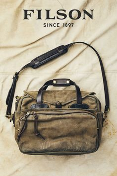 The Filson legendary Original Briefcase is built with signature Rugged Twill and Bridle Leather. Canvas Leather, Leather Bag, Waxed Cotton Jacket, Bag Accessories, Diaper Bag, Mens Fashion, Outfit, Designer Handbags, Designer Purses