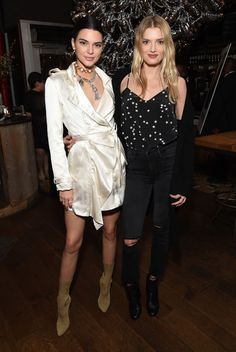 Kendall Jenner rocked a satin wrap dress with statement jewelry and beige boots while Lily Donaldson worked distressed denim and a dotted blouse.