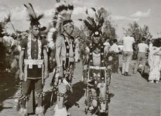 L-R: unidentified, Henry Snake (Ponca), Wilson Ahboah (Kiowa) in dance clothes at the American Indian Exposition in Anadarko, Oklahoma - 1947