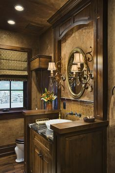 half bath heaven - framed and built in cabinetry work with sconces attached - add a lit magnifying mirror as well