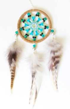 3 inch Full Beaded Dream Catcher - handmade with tan suede, glass sead beads and brown hackle feathers. You can find more designs at https://www.facebook.com/pages/Dreamscape/471890606282556