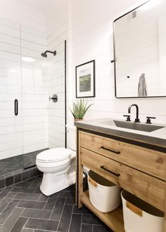 Looking for White Bathroom ideas? Browse White Bathroom images for decor, layout, furniture, and storage inspiration from HGTV. Hall Bathroom, Bathroom Renos, Shiplap Wall In Bathroom, Bathroom With Wood Floor, Charcoal Bathroom, White Shiplap Wall, Guest Bathroom Remodel, Bathroom Paneling, Condo Bathroom