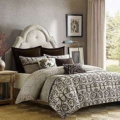 Inspired by the beautiful artwork of Norman Wyatt Jr., the Loire Comforter Set from Art In Motion has an exquisite ironwork and typography pattern in espresso that plays off a neutral parchment base. Deep shadow printing techniques add rich dimension.