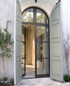 W Bridge House Steel Doors Shutters Architecture Shutter Doors Doors, Arched Doors, Exterior Doors, House Exterior, Shutter Doors, Windows And Doors, Windows, Front Door, French Doors