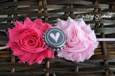"Double shades of pink shabby flower with a heart bottle cap center embellishment. Headband is pink- but can be made to order with whatever color you would like!  Flowers measure approximately 2.5"" each.  When ordering, please indicate the size needed at checkout. If possible, measuring is t..."