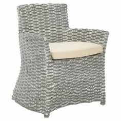 "The perfect addition to your living room or den, this rattan arm chair features a grey whitewash finish and cotton seat cushion. Product: Chair    Construction Material: Rattan and cotton    Color: Grey whitewash and cream     Features: Woven design 17.3""  Seat heightCushion included           Dimensions: 33.1"" H x 27.2"" W x 28"" D"