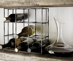 Grid up to nine wine bottles in our exclusive wine rack, handcrafted of iron for a rustic, industrial look.