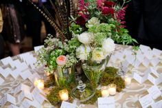 Pheasant-Feather-and-Moss-Woodsy-Wedding-Centerpiece