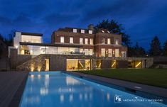 This #contemporaryextension to an old brick home in Totteridge created a series of contemporary internal spaces. Five Keller #minimal windows were used to provide a large open plan #familylivingspace that opens out onto the rear terrace.  A #minimalpivotwindow was also installed to the ground floor of this home to allow access to and from the pool area. The thin aluminium frame perfectly matches the minimal windows® sliding glass doors.  Credit: F3 Architects Sliding Glass Door, Glass Doors, Old Bricks, Indoor Outdoor Living, House Extensions, Open Plan, Ground Floor, Contemporary, Modern
