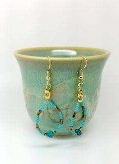 Blue long earrings - ocean blue earrings are made using seed turquoise beads, gold beads and 6mm light blue Swarovski. Measure: 2 inch